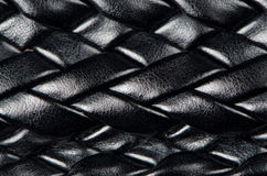 Black leather woven pattern. Woven pattern black leather belt background Royalty Free Stock Images