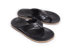 Black leatherette slippers. Stock Photos