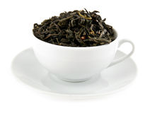 Black leaves tea in cup Royalty Free Stock Images