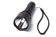 Black LED torch flashlight. On a white background royalty free stock photos