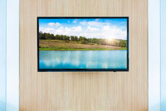 Black LED tv television screen mockup. Landscape on monitor Stock Photos