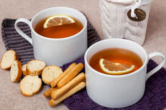 Black Lemon Tea on Knitted Napkins Stock Photos