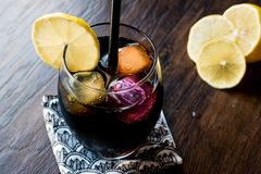 Black lemonade with charcoal, lemon and colorful bubble ice cube. S. Organic Beverage Stock Images