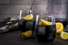 Black Lemonade With Ice And Lemon Royalty Free Stock Photos