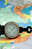 Black Lensatic Compass. A black lensatic compass on hiking map Royalty Free Stock Images