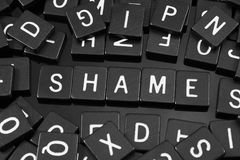 Free Black Letter Tiles Spelling The Word & X22;shame& X22; Royalty Free Stock Image - 95859646