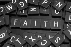 Black letter tiles spelling the word & x22;faith& x22; royalty free stock photos