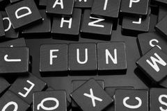Black letter tiles spelling the word & x22;fun& x22; stock photos