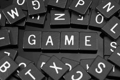 Black letter tiles spelling the word & x22;game& x22; royalty free stock photo