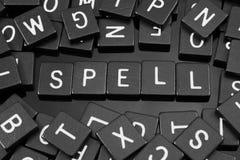 Black letter tiles spelling the word & x22;spell& x22; Stock Photos