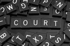 Black letter tiles spelling the word & x22;court& x22;
