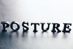 Black letters forming word POSTURE. On grey backgroud royalty free stock image