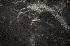 Black limestone rock texture background Royalty Free Stock Images