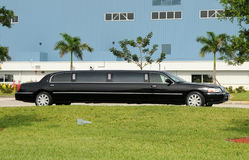 Black limo. Black stretched limo awaiting passengers Stock Image