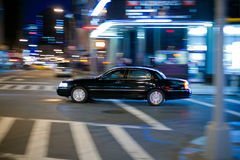 Black Limo at the crossroads Royalty Free Stock Photo