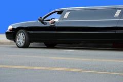 Black limousine Stock Images