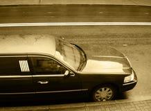 Black limousine. Black limousine on the rainy street Stock Photography