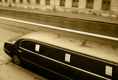 Black limousine. On a rainy street Royalty Free Stock Photo