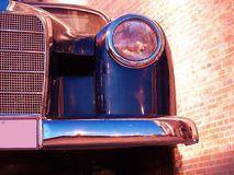 Black Limousine. A view of the left headlight & bumper of a vintage limousine Royalty Free Stock Photos