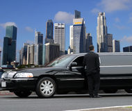 Black limousine in Singapore. Limousine driver waiting for passenger in Singapore Stock Photography