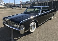 Black Lincoln Continental limousine classic car from 1965 seen from outside. Copenhagen, Denmark - April 19, 2019 stock photo