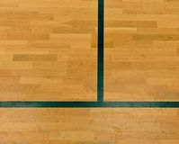 Black lines in hall playground. Worn out wooden floor of sports hall with lines royalty free stock photos