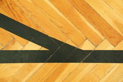 Black lines in hall. Worn out wooden floor of sports hall with colorful marking lines Royalty Free Stock Photo