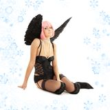 Black lingerie angel with pink hair and snowflakes Royalty Free Stock Photo