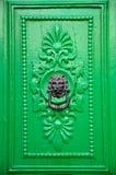 Black Lion Head Door Knocker. On green door in Valletta, Malta Royalty Free Stock Photo