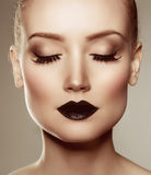 Black lips. Halloween Makeup. Luxury beautiful woman with dark l Royalty Free Stock Images