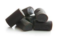 Black liquorice candies. Royalty Free Stock Images
