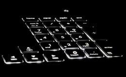 Black lit keyboard. LED lit black keyboard alphanumeric Royalty Free Stock Photo