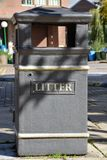 Black litter bin in the streets from the front. A black litter bin in the streets from the front Royalty Free Stock Photography