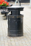 Black litter bin Stock Images
