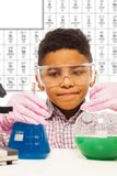 Black little boy experiments with chemistry stock photos