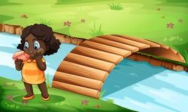A Black little girl near the bridge Royalty Free Stock Image