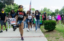 Black Lives Matter Protest Juneteenth March George Floyd - Protesters marching in front of American Flag in Teaneck NJ