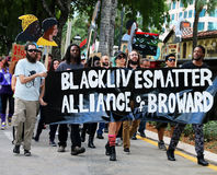 Black Lives Matter. Protesters  holding a large sign that said Black Stock Photography