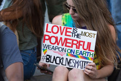 Black lives matter protestor holding a poster during march on Ci Stock Photography