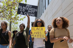 Black lives matter protestors holding a poster during march on C stock photography