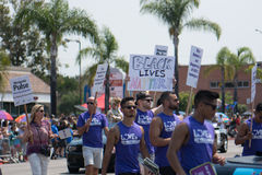 Black Lives Matter Remember Pulse Recuerdo Pulse in San Diego Pride Parade. Men in the San Diego pride parade hold signs as they march saying Black Lives Matter royalty free stock image