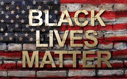 Black lives matter slogan on American flag. Wall background Stock Image