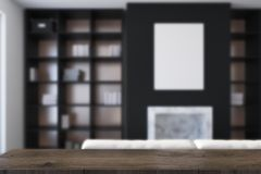 Black living room, fireplace and bookcases blurred Stock Photo
