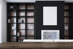Black living room, fireplace and bookcases Royalty Free Stock Photo