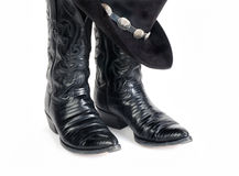 Black Lizard Cowboy Boots and Hat with Concho Hatband. Royalty Free Stock Photography