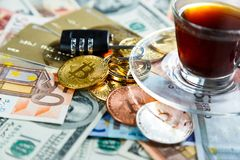 Black lock on bitcoins, litcoins - crypto currency on real money background. Internet security, risk, investment, business. Black lock on bitcoins, litcoins stock photo
