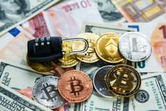 Black lock on bitcoins, litcoins - crypto currency on real money background. Internet security, risk, investment, business. Concept royalty free stock images