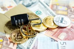 Black lock on bitcoins, litcoins - crypto currency on real money background. Internet security, risk, investment, business. Concept royalty free stock photography