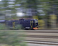 Black locomotive. A black locomotive against a blurred background Stock Photos