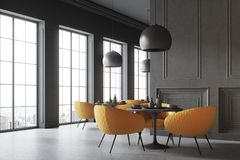 Black loft cafe corner. Black restaurant corner with a concrete floor, round black tables and yellow chairs. A blank wall fragment. 3d rendering mock up Stock Photo